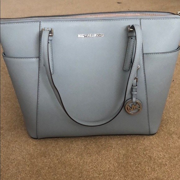 eafafb441e194c Light blue Michael Kors Jet Set Travel Large Bag. Michael Kors.  M_5ab589068df470aa5395da6f. M_5ab5890f05f4307a053b409a.  M_5ab5895a00450fdb69467a25